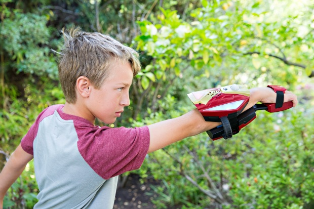 A child plays with the Repulsor, part of the Playmation Marvel's Avengers starter pack.  GearFriday, May 15, 2015 in Encino, Calif. (Photo by Colin Young-Wolff/Invision for Disney/AP Images)